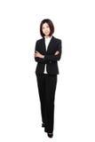 In voller Länge überzeugtes Lächeln der Geschäftsfrau Stockfotos