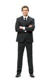 In voller Länge vom Geschäftsmann mit den Händen gekreuzt Lizenzfreie Stockfotos