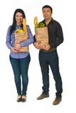 In voller Länge von den Paaren mit Einkaufennahrung stockfoto