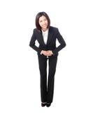 In voller Länge von der Geschäftsfrau nehmen Sie einen Bogen lizenzfreies stockbild
