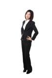 In voller Länge überzeugtes Lächeln der Geschäftsfrau Lizenzfreies Stockbild