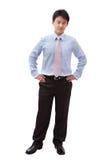 In voller Länge Geschäftsmann mit überzeugtem Lächeln Lizenzfreie Stockfotos