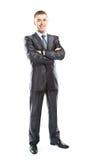 Volles Körperporträt des jungen glücklichen lächelnden netten Geschäftsmannes Stockbild