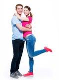 Volles Porträt von glücklichen attraktiven Paaren Stockfotografie