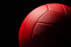 Volley ball. Red volley ball against a  black background Royalty Free Stock Image