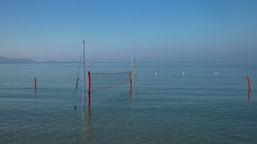 Volley Ball. Landscape image of volley ball net in ocean Royalty Free Stock Images