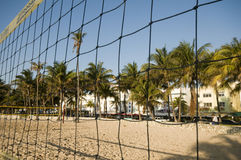 Volley ball court south beach miami. SOUTH BEACH, MIAMI-APRIL 20: The volleyball sports field in the morning light with restored art deco hotels and coconut Stock Photo