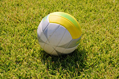 Volley ball on grass. Volley ball on green grass field isolated Royalty Free Stock Image
