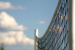 Volley ball net. Close up of a volley ball net with a cloudy background Royalty Free Stock Photography