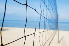 Volley ball net on the beach. A volley ball net on the beach Royalty Free Stock Photos