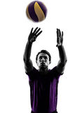 Volley ball player man silhouette white background. Young volley ball player man in silhouette white background Stock Photo