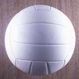 Volley Ball. White volley ball over a wooden table Stock Image