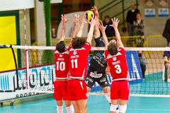 Volley. MILAN, ITALY - APRIL, 10:  Diaz Padura ( Corigliano Volley) against Botto, Beretta and Tiberti (Monza)     in A2M PLAY - OFF Vero Volley Monza Stock Images