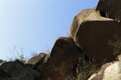 Volley rock, hanging on the path. Huge rock above, volley hanging rock, crevice plants is growing Royalty Free Stock Photography