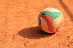 Volleyball ball on clay Royalty Free Stock Photo