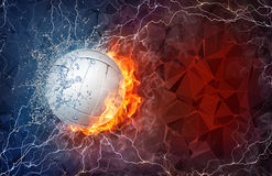 Volleyball ball in fire and water. Volleyball ball on fire and water with lightening around on abstract polygonal background. Horizontal layout with text space Stock Photography
