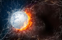 Volleyball ball in fire and water. Volleyball ball on fire and water with lightening around on black background. Horizontal layout with text space Royalty Free Stock Photo
