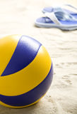 Volleyball ball and flip-flops Stock Image