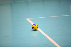 Volleyball ball on the floor Royalty Free Stock Images