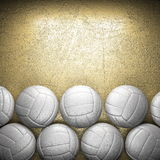 Volleyball ball and golden wall Stock Photography