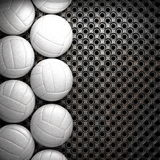 Volleyball ball and metal wall Stock Photo