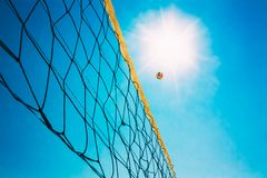 Volleyball Ball Over Net On Background Of Blue Royalty Free Stock Images