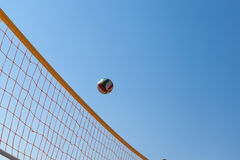 Volleyball Ball Over Net Stock Photo