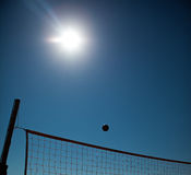 Volleyball Ball Over Net Stock Images