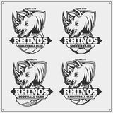 Volleyball, baseball, soccer and football logos and labels. Sport club emblems with rhino. royalty free illustration