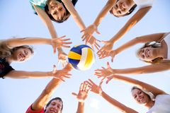 Volleyball on the beach. Group of young people playing volleyball on the beach Stock Photo