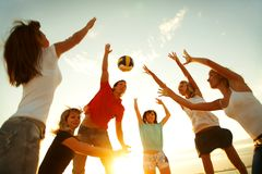 Volleyball on the beach. Group of young people playing volleyball on the beach Royalty Free Stock Photos