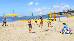 Volleyball on the beach. The Volleyball completions was played on the soft sand at Eastern Beach, Geelong. Victoria. Australia. It was all part the Stock Photography