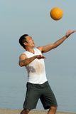 Volleyball on the beach. Young men playing volleyball on the beach Stock Photo