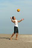 Volleyball on the beach. Young men playing volleyball on the beach Royalty Free Stock Image