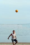 Volleyball on the beach. Young men playing volleyball on the beach Royalty Free Stock Photo