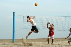 Volleyball on the beach. Young men playing volleyball on the beach Royalty Free Stock Photography