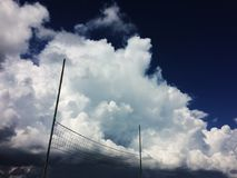 Volleyball on the beach with clouds on background, cumulus clouds before thunderstorm Ukraine beach. Volleyball on the beach with clouds on background, cumulus royalty free stock photos