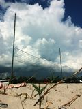 Volleyball on the beach with clouds on background, cumulus clouds before thunderstorm Ukraine beach. Volleyball on the beach with clouds on background, cumulus stock photos