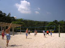 Volleyball in the Caribbean. Sunlights bathes the sandy shore in Labadee, Haiti Stock Image