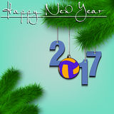Volleyball and 2017 on a Christmas tree branch. Happy New Year and numbers 2017 and volleyball ball as a Christmas decorations hanging on a Christmas tree branch Stock Photo