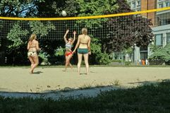 Volleyball in the city. Three girls playing beach-volleyball in the middle of berlin; summer of 2006 stock photo