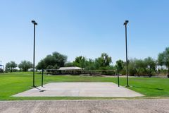 Volleyball court surrounded by grass in a city park stock images