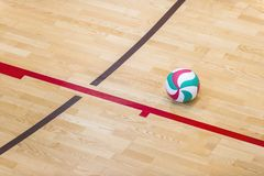 Volleyball court wooden floor with ball isolated on black with copy-space stock photos
