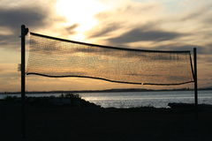 Volleyball de coucher du soleil Photos stock