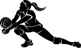 Volleyball Dig Girl Silhouette. Silhoutee of a female volleyball player returning a ball with a dig Stock Photos