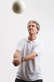 Volleyball for ever. One man in a white shirt is playing volleyball Royalty Free Stock Images