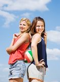 Volleyball female players with a ball Royalty Free Stock Photo