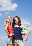 Volleyball female players with ball Royalty Free Stock Photos