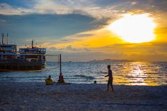 Volleyball game at Koh Samui Pier in amazing. Sunset Royalty Free Stock Images