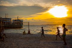 Volleyball game at Koh Samui Pier in amazing. Sunset Stock Photography